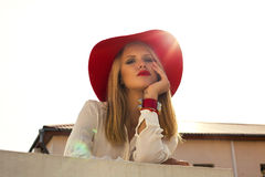 Fashion photo of beautiful blond girl in red hat Stock Images