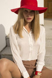 Fashion photo of beautiful blond girl in red hat Stock Image