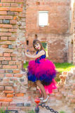 Fashion photo of a beautiful girl  on a background of brick ruin Royalty Free Stock Images