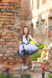 Fashion photo of a beautiful girl  on a background of brick ruin Stock Photos