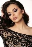 Beautiful girl with dark hair and evening makeup in luxurious bl stock photo