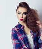 Fashion photo of a beautiful girl with red lips, big eyes, bright makeup and stylish hair salon Royalty Free Stock Images