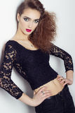 Fashion photo of a beautiful girl with red lips, big eyes, bright makeup and stylish hair salon Stock Photography