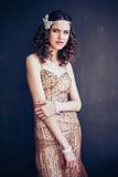 Fashion photo of beautiful girl wearing sparkling evening dress. Stock Image