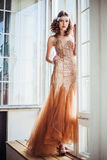 Fashion photo of beautiful girl wearing sparkling evening dress Stock Photos