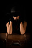 Fashion photo of beautiful lady in elegant black hat Royalty Free Stock Photo