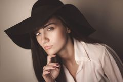 Fashion photo of beautiful lady in elegant black hat and white s royalty free stock photo