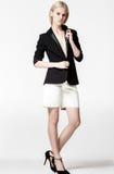 Fashion photo of beautiful lady in elegant black suit. White background,studio Royalty Free Stock Image