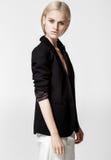Fashion photo of beautiful lady in elegant black suit. White background,studio Royalty Free Stock Images