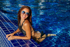 Fashion photo of beautiful tanned woman in elegant black bikini Royalty Free Stock Photos
