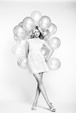 Fashion photo of beautiful woman with balloon. Girl posing Stock Photos
