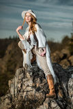 Fashion photo of beautiful woman at mountain Stock Images