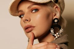 Beautiful woman with short blond hair in elegant clothes with accessories posing in studio. Fashion photo of beautiful woman with short blond hair in elegant royalty free stock photos