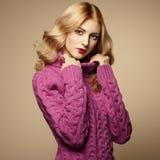 Fashion photo of beautiful woman in sweater Stock Photography