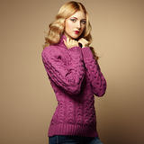 Fashion photo of beautiful woman in sweater Royalty Free Stock Image