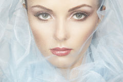 Fashion photo of beautiful women under blue veil Royalty Free Stock Photo