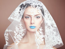 Fashion photo of beautiful women under white veil Stock Images