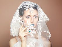 Fashion photo of beautiful women under white veil Royalty Free Stock Image