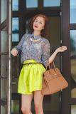 Fashion photo of beautiful young woman with bag. Stock Image