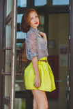 Fashion photo of beautiful young woman with bag. Royalty Free Stock Images
