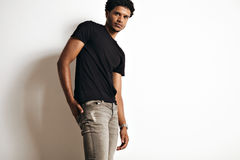 Fashion photo of a handsome man in black t-shirt Stock Photography