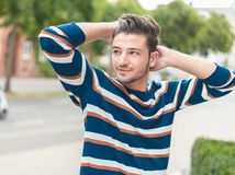 Fashion photo of handsome young man posing stock images