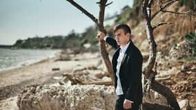 Fashion photo of the man on a seaside Stock Images