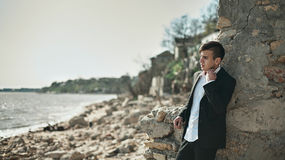 Fashion photo of the man on a seaside Stock Photography