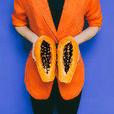 Fashion photo. Model with papaya fruit. Royalty Free Stock Photo