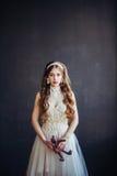 Fashion photo of sad girl wearing wedding dress. Fashion photo of young beautiful girl wearing wedding dress. Sad bride holding teddy bear. Professional make-up royalty free stock photo