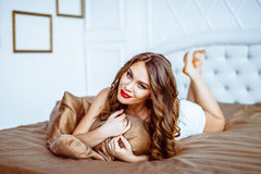 Girl in lingerie on the bed Royalty Free Stock Photo