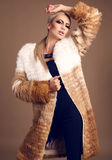 Fashion photo of sexy glamour blond woman in luxurious fur coat Royalty Free Stock Photography