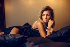 Beautiful woman lying on bed top view Royalty Free Stock Images