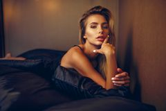 Beautiful woman lying on bed top view Stock Photography