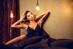 Beautiful woman lying on bed top view Stock Image