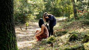 Fashion photo shoot in forest photographer with female model stock video footage