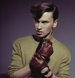 Fashion photo shot of a man wearing gloves Royalty Free Stock Photos