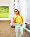Fashion photo stylish woman in sunglasses posing in the city Stock Images