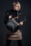 Fashion photo of stylish young woman in leather look. Fashion photo of stylish young woman in leather Royalty Free Stock Photography