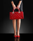 Fashion photo,woman with a red bag Stock Images