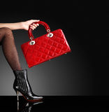 Fashion photo, Woman sexy legs with handbag Stock Photos