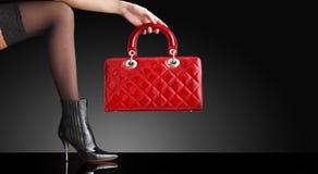 Fashion photo, Woman sexy legs with handbag Stock Photos