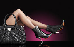 Fashion photo, Woman sexy legs with handbag Royalty Free Stock Images