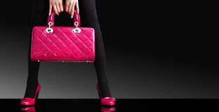 Fashion photo, Woman sexy legs with handbag Royalty Free Stock Image