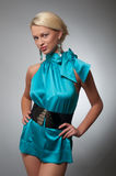 Fashion photo of a woman in short cyan dress. Fashion photo of a blond woman in cyan dress royalty free stock photo