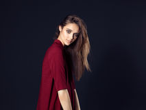 Fashion photo of young beautiful woman on black background. Royalty Free Stock Photos