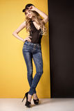 Fashion photo of young girl in jeans. Royalty Free Stock Photography