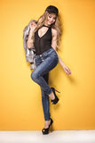 Fashion photo of young girl in jeans. Stock Photo