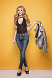 Fashion photo of young girl in jeans. Stock Images