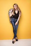Fashion photo of young girl in jeans. Royalty Free Stock Photo
